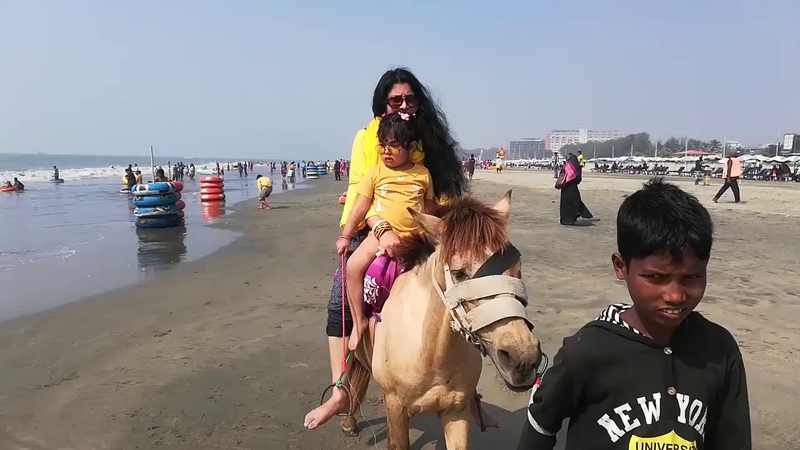 Ponyboy Majumdar and her mother is enjoying horse ride at Cox's Bazar