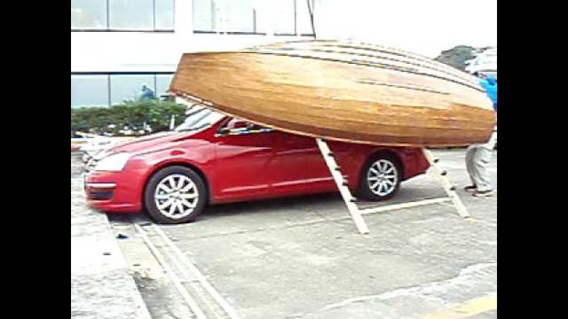 Boat climbs to car top by single hand