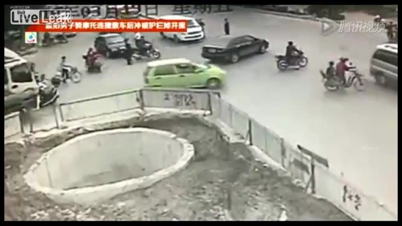 LiveLeakcom Must See Scooter man ends up in big hole after hitting multiple vehicles