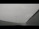 Дворники не справлялись с ливнем на Крымскому мосту днем 16.07.2018.