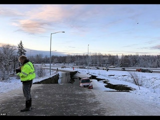 Anchorage 7.0 magnitude earthquake leaves residents running for cover, roads cracked