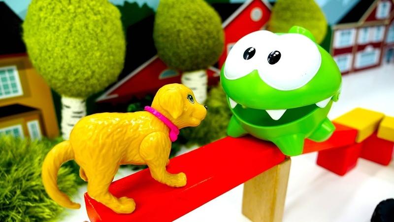 Video e giochi per bambini. Om Nom compra un cucciolo. Il negozio di Barbie
