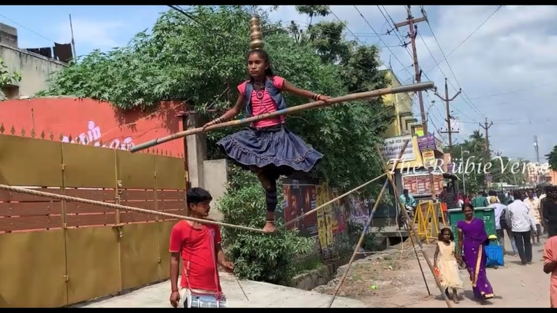 Amazing Girl Walking Dancing in One Leg on 2 inches Rope with Pots on Head Tamil Nadu