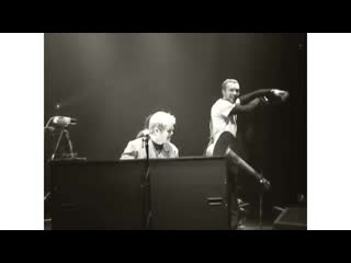 Coldplay performing Trouble with Elton John