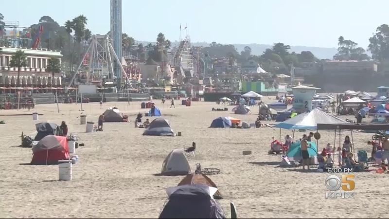 Tourists And Growing Homeless Encampment Share Santa Cruz Sands