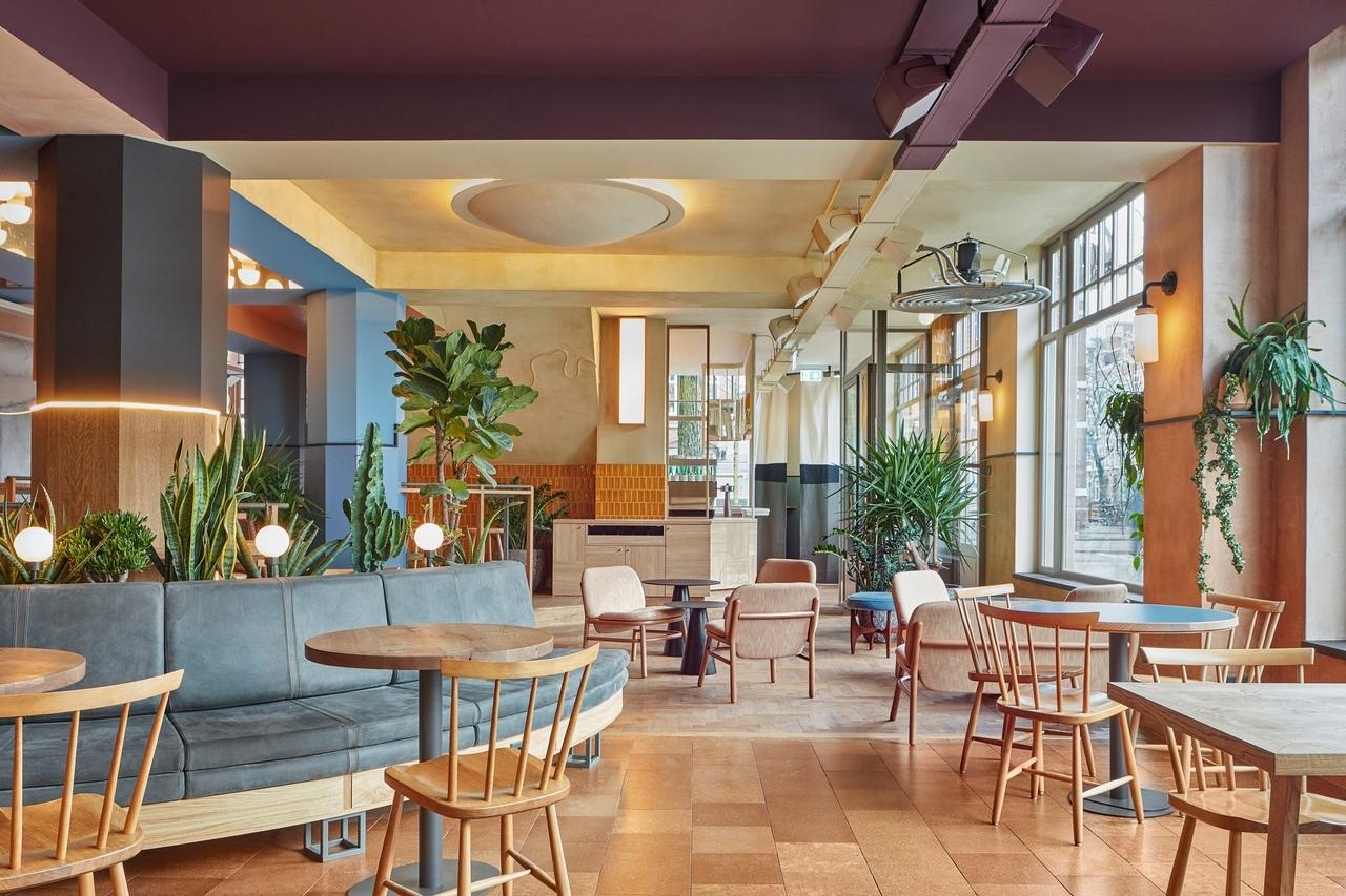 Amsterdam's Karavaan restaurant has colourful interiors by Studio Modijefsky