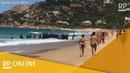Spanien Afrikanische Flüchtlinge stürmen auf Badestrand