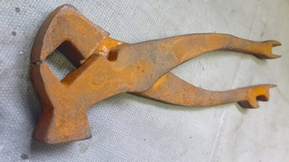 Restoration of rusty antique boot tongs. Mirror polished.