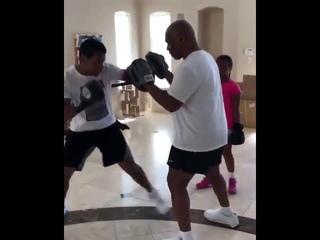MEET MIKE TYSON'S SON WHO'S BEING TRAINED BY THE LEGEND ON THE PADS.